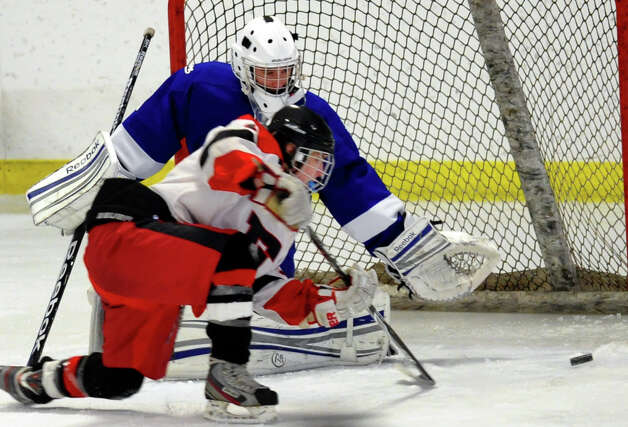 Fairfield Warde/Ludlowe's #11 Kevin Robinson scores a goal against Darien, during boys hockey action at the Wonderland of Ice in Bridgeport, Conn. on Saturday January 12, 2013. Photo: Christian Abraham / Connecticut Post
