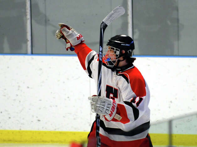 Fairfield Warde/Ludlowe's #11 Kevin Robinson celebrates after scoring a goal against Darien, during boys hockey action at the Wonderland of Ice in Bridgeport, Conn. on Saturday January 12, 2013. Photo: Christian Abraham / Connecticut Post