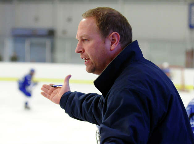 Darien Head Coach Chris Gerwig, during boys hockey action against Fairfield Warde/Ludlowe at the Wonderland of Ice in Bridgeport, Conn. on Saturday January 12, 2013. Photo: Christian Abraham / Connecticut Post