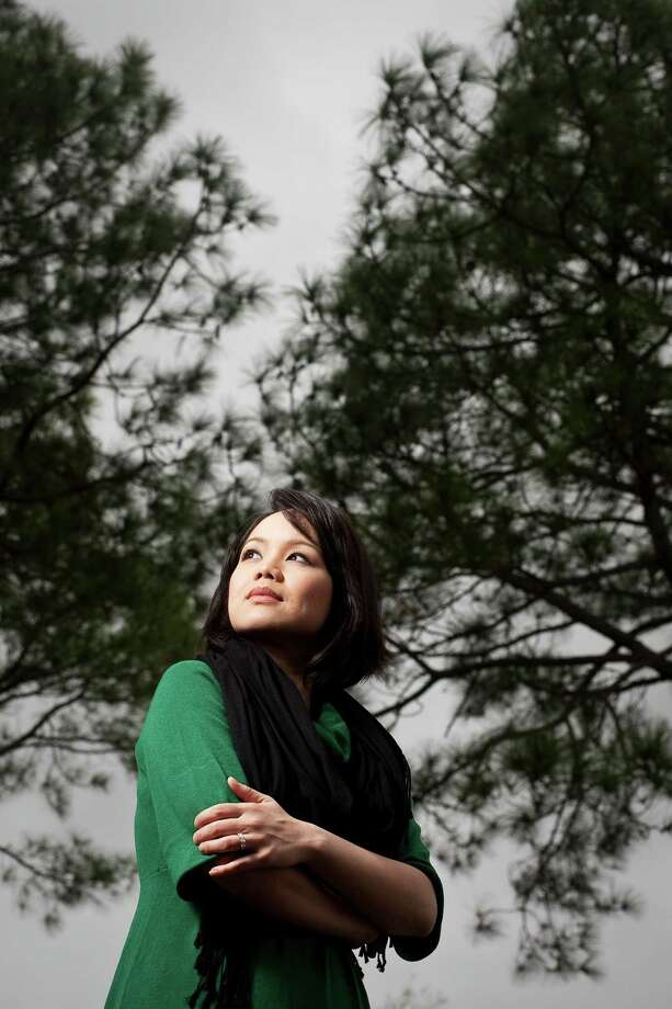 Andrea Nguyen, unnerved by a stalker in 2005 while working on the air in San Diego, has since become a Houston-area teacher. Photo: Nick De La Torre, Staff / © 2013  Houston Chronicle