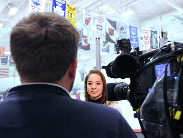Elena Glebova, an Estonian national figure skating champion, gets interviewed by a reporter during a visit to the Boys & Girls Club of Greenwich, Saturday night, Jan. 12, 2013. Photo: Bob Luckey / Greenwich Time