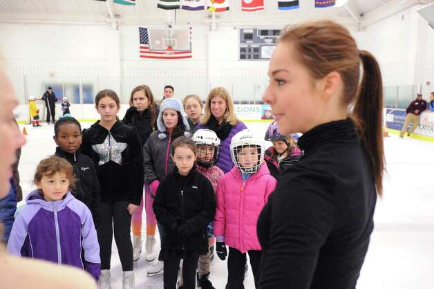 Skaters look at Elena Glebova, an Estonian national figure skating champion, during a visit by Glebova to the Boys & Girls Club of Greenwich, Saturday night, Jan. 12, 2013. Photo: Bob Luckey / Greenwich Time