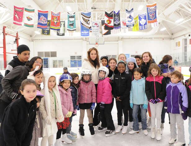 At center, Elena Glebova, an Estonian national figure skating champion, poses for a group photo with skaters during a visit to the Boys & Girls Club of Greenwich, Saturday night, Jan. 12, 2013. Photo: Bob Luckey / Greenwich Time