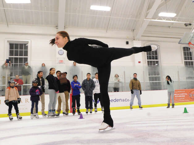 Elena Glebova, an Estonian national figure skating champion, demonstrates skating technique during a visit at the Boys & Girls Club of Greenwich, Saturday night, Jan. 12, 2013. Photo: Bob Luckey / Greenwich Time