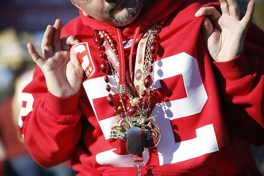 Tony Pulido, of Vallejo, displays a collection of 49ers ornaments in the parking lot outside Candlestick Park prior to a NFL football game between the San Francisco 49ers and Green Bay Packers in San Francisco, Calif. on Saturday, January 12, 2013. Photo: Stephen Lam, Special To The Chronicle