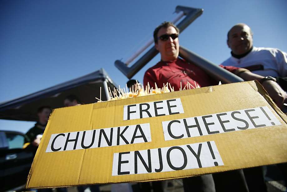 Bill Jennings of Sonora offers cheese to fellow fans in the parking lot at Candlestick Park before the game between the 49ers and Green Bay Packers. Photo: Stephen Lam, Special To The Chronicle