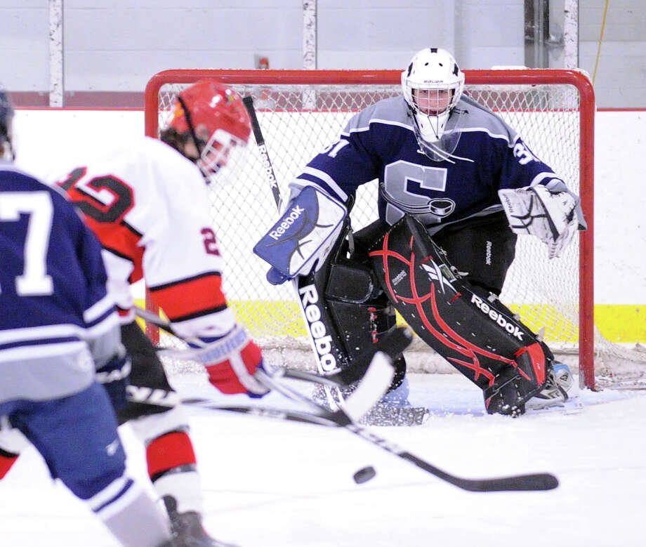Billy Lewis # 12 of Greenwich lines-up a shot as SWS goalie Matt Beckoff prepares to make a stop during the boys high school ice hockey game between Staples-Weston-Shelton High School High School and Greenwich High School at Hamill Rink in Byram, Saturday night, Jan. 12, 2013. Photo: Bob Luckey / Greenwich Time