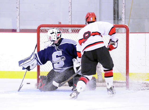 SWS goalie Matt Beckoff # 31 wathces as a first period shot by Alex Bastone # 9 of Greenwich goes wide during the boys high school ice hockey game between Staples-Weston-Shelton High School and Greenwich High School at Hamill Rink in Byram, Saturday night, Jan. 12, 2013. Photo: Bob Luckey / Greenwich Time