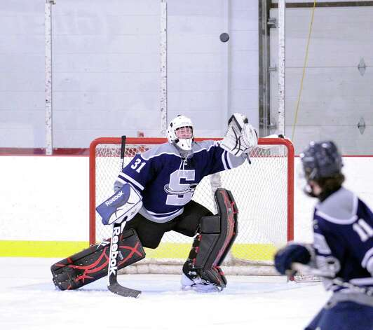 SWS goalie Matt Beckoff # 31 plays a deflected shot during the boys high school ice hockey game between Staples-Weston-Shelton High School High School and Greenwich High School at Hamill Rink in Byram, Saturday night, Jan. 12, 2013. Photo: Bob Luckey / Greenwich Time