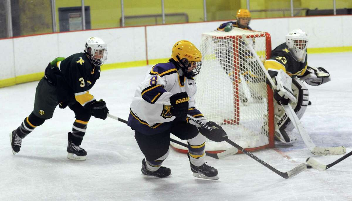 Westhill's Ryan Silk controls the puck during Saturday's boys ice hockey game against Trinity Catholic at Terry Connors Rink in Stamford on January 12, 2013.