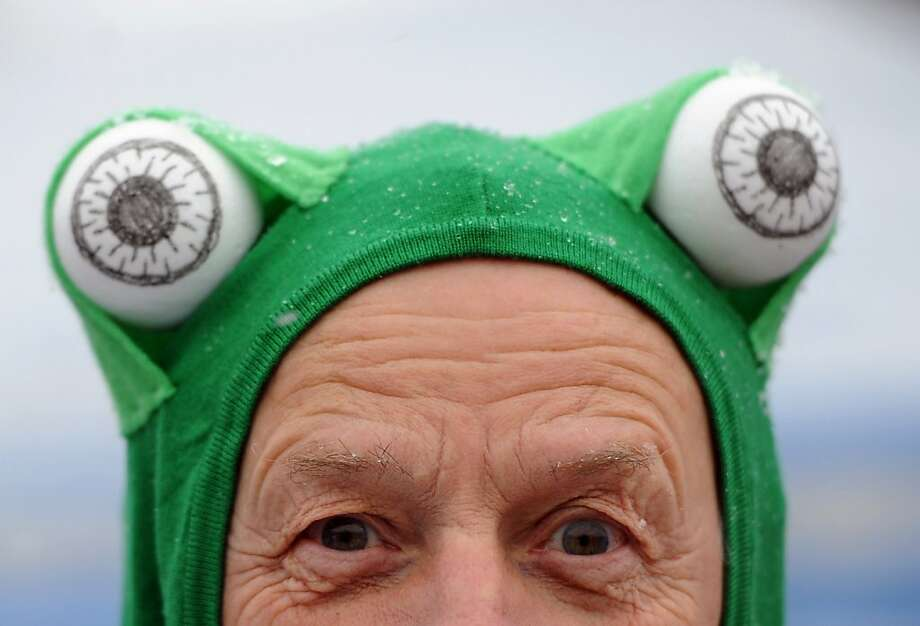 An ice swimmer wears a green cap with two table tennis balls at the Oranke sea in Berlin, on January 12, 2013.Spectators and ice bathers from 17 clubs enjoyed the cold water. Photo: Britta Pedersen, AFP/Getty Images