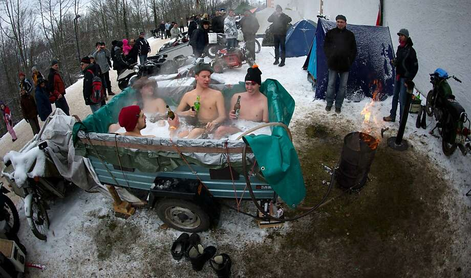 Bikers take a bath in a self-constructed bath tube in front of the Augustusburg Castle in Augustusburg, eastern Germany, on January 12, 2013. Up to 1,500 bikers from whole Europe  attend the event, the tradition goes back to 1971. Photo: Arno Burgi, AFP/Getty Images