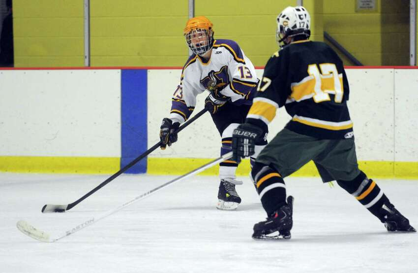 Westhill's Scott Reveille looks for a shot during Saturday's boys ice hockey game against Trinity Catholic at Terry Connors Rink in Stamford on January 12, 2013.