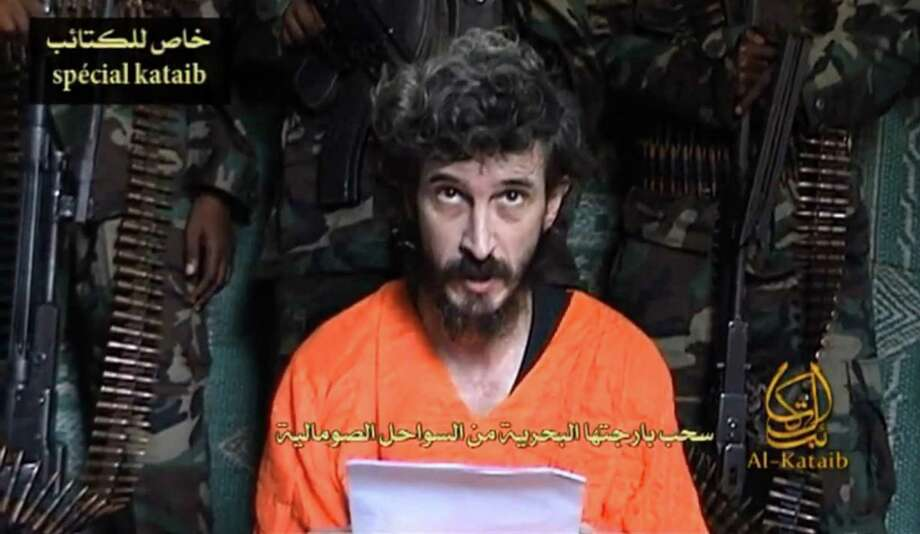 FILE- In this undated file image from a video posted on islamic militant websites  and made available Wednesday June 9 2010, a man identified as French security agent Denis Allex pleads for his release from the Somali militant group al-Shabaab who have been holding him for nearly a year. A French commando raid in Somalia to free a captive intelligence agent ended in the deaths of 17 Islamists and a French soldier. France said the hostage also died in the failed rescue, but the man's captors denied he had been killed and claimed Saturday, Jan. 12, 2013, to have seized a second soldier. (AP Photo, File) Photo: Anonymous