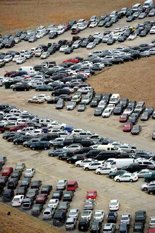 Tens of thousands of vehicles damaged by super storm Sandy are being temporarily stored on runways and taxiways at Calverton Executive Airpark in Calverton, New York, on January 9, 2013 in this aerial view. Insurance Auto Auctions Inc, a salvage auto auction company specializing in total-loss vehicles, acquired the cars and trucks that were damaged, destroyed or flooded by the storm and needed a place to store them. The company made a deal with the Town of Riverhead to lease the airport land and then the vehicles are auctioned online. AFP PHOTO/Stan HONDASTAN HONDA/AFP/Getty Images Photo: STAN HONDA