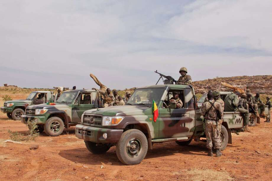 "In this Nov. 24, 2012 photo, soldiers from a Malian army special unit stand atop pick-ups mounted with machine guns, following a training exercise in the Barbe military zone, in Mopti, Mali.  Secretary-General Ban Ki-moon said Friday, Jan. 11, 2013,  that France, Senegal and Nigeria have responded to an appeal from Mali's President Dioncounda Traore for help to counter an offensive by al-Qaida-linked militants who control the northern half of the country and are heading south. The U.N. chief said that assisting the Malian defense forces push back against the Islamist armed groups is ""very important.""(AP Photo/Francois Rihouay) Photo: Francois Rihouay"