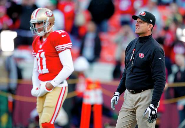 San Francisco 49ers head coach Jim Harbaugh and quarterback Alex Smith (11)warm up before an NFC divisional playoff NFL football game against the Green Bay Packers in San Francisco, Saturday, Jan. 12, 2013. Photo: Tony Avelar, Associated Press / FR155217 AP