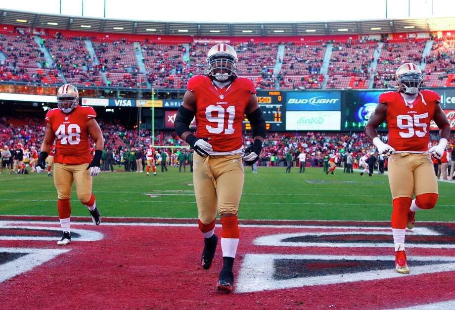 Tight end Garrett Celek (48), Defensive tackle Ray McDonald (91) and Defensive tackle Ricky Jean Francois (95) warm up before the San Francisco 49ers game against the Green Bay Packers in the NFC Divisional Playoffs at Candlestick Park in San Francisco, Calif., on Saturday January 12, 2013. Photo: Luanne Dietz, The Chronicle / ONLINE_YES