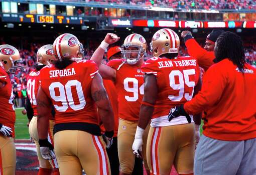 Defensive tackle Justin Smith (94) with the defensive line before the San Francisco 49ers game against the Green Bay Packers in the NFC Divisional Playoffs at Candlestick Park in San Francisco, Calif., on Saturday January 12, 2013. Photo: Brant Ward, The Chronicle / ONLINE_YES