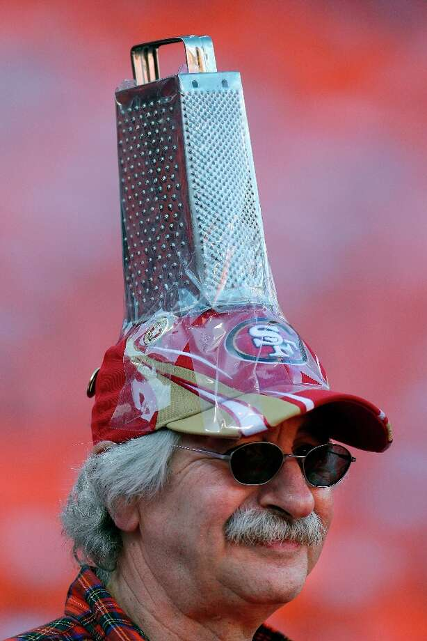 San Francisco 49ers fan John Boulos wears a cheese grater on his hat as he watches players warm up before an NFC divisional playoff NFL football game between the San Francisco 49ers and the Green Bay Packers in San Francisco, Saturday, Jan. 12, 2013. Photo: Ben Margot, Associated Press / AP