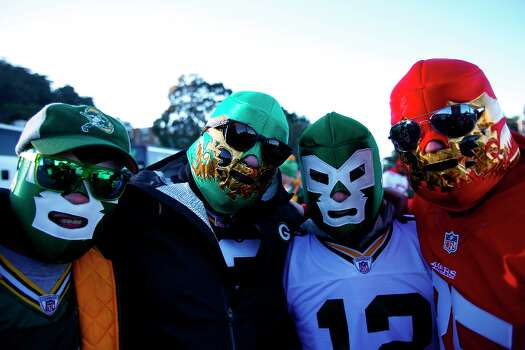 (L-R) Helio Ceniceros, Rene Arce, Jayce Cantu, and Rodrigo Wise wear mask representing Green Bay Packers and San Francisco 49ers prior to a NFL football game at Candlestick Park in San Francisco, Calif. on Saturday, January 12, 2013. Photo: Stephen Lam, Special To The Chronicle / ONLINE_YES