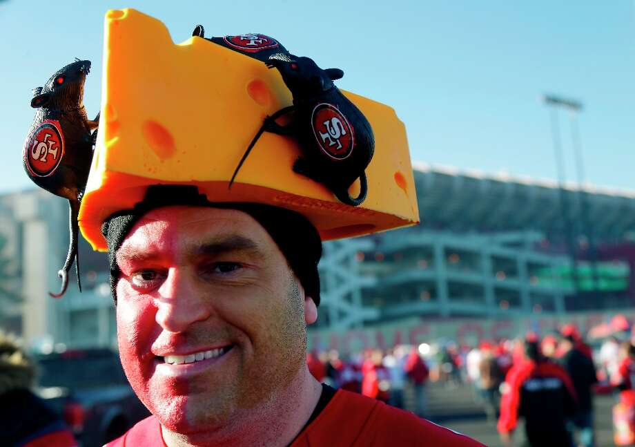 San Francisco 49ers fan John Germany wears a cheesehead hat with rats in the parking lot of Candlestick Park before an NFC divisional playoff NFL football game between the San Francisco 49ers and the Green Bay Packers in San Francisco, Saturday, Jan. 12, 2013. Photo: Marcio Jose Sanchez, Associated Press / AP
