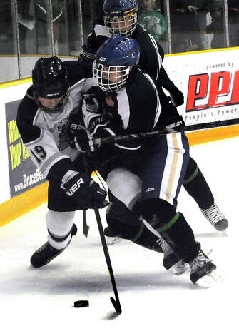 The Newtown High School Ice Hockey team, the Nighthawks, play the Shepaug Spartans at the Danbury arena in a special hockey game honoring the victims and first responders of the Sandy Hook Elemantry School tragedy, Saturday, Jan. 12, 2013. Newtown wears green uniforms with the letters SHES for the game. Photo: Michael Duffy / The News-Times