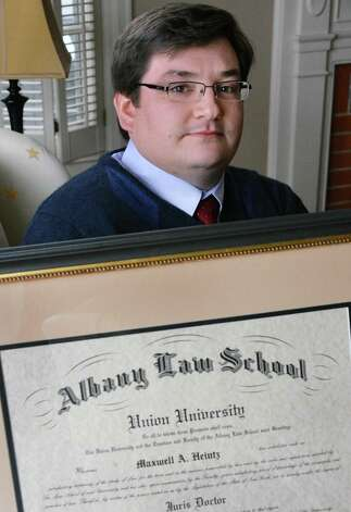 Max Heintz, 28, a 2012 graduate of Albany Law School with his diploma at his parent's Scotia home Friday Jan. 11, 2013.  (John Carl D'Annibale / Times Union) Photo: John Carl D'Annibale / 00020732A