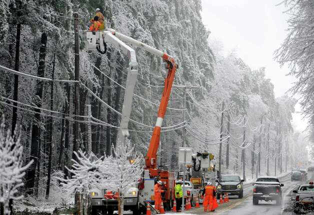 National Grid lineman work to restore power on Dunning Road in Malta, N.Y., Dec. 12, 2008. (Skip Dickstein / Times Union archive) Photo: SKIP DICKSTEIN