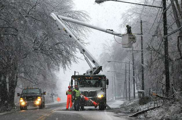 Utility workers repair damaged and fallen cables due to storm damage along Route 378 in Loudonville, N.Y.,  Dec. 12, 2008. (Steve Jacobs / Times Union archive) Photo: STEVE JACOBS / 00001658B