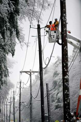 National Grid lineman work to restore power in the Malta, N.Y., Dec. 12, 2008. (Skip Dickstein / Times Union archive) Photo: SKIP DICKSTEIN