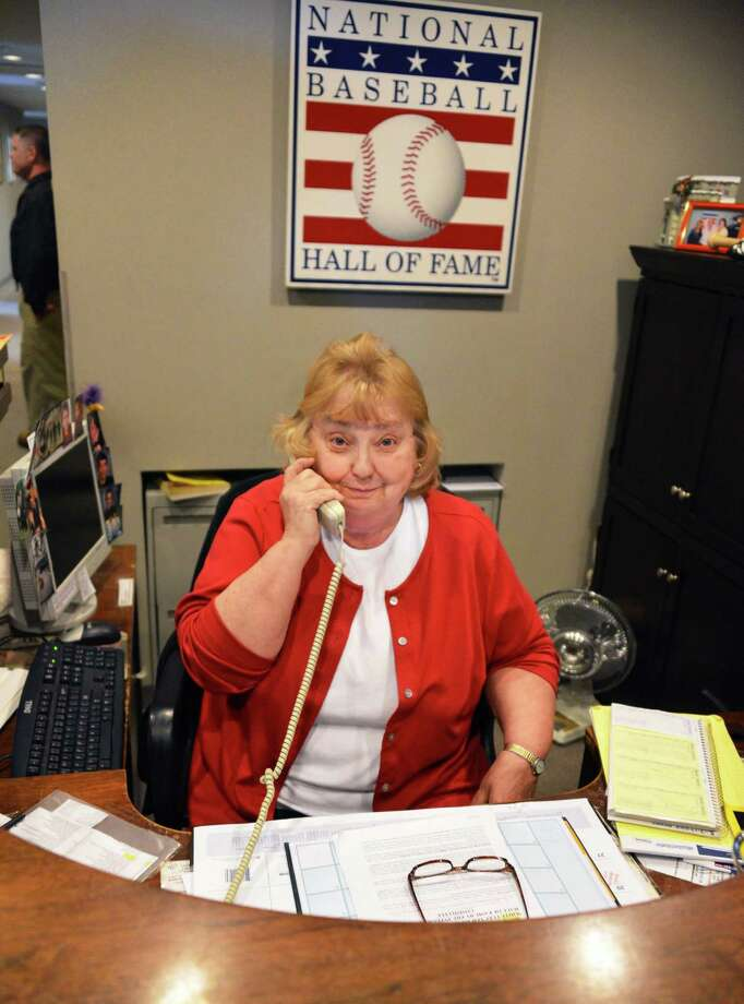 National Baseball Hall of Fame visitor services supervisor Nancy Oldick assures callers that there will be a Hall of Fame Induction Ceremony this year in Cooperstown Thursday Jan. 10, 2013. (John Carl D'Annibale / Times Union) Photo: John Carl D'Annibale