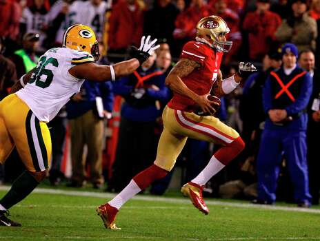 San Francisco 49ers quarterback Colin Kaepernick (7) runs pass Green Bay Packers defensive end Mike Neal (96) for a touchdown in the first quarter of the San Francisco 49ers game against the Green Bay Packers in the NFC Divisional Playoffs at Candlestick Park in San Francisco, Calif., on Saturday January 12, 2013. Photo: Carlos Avila Gonzalez, The Chronicle / ONLINE_YES