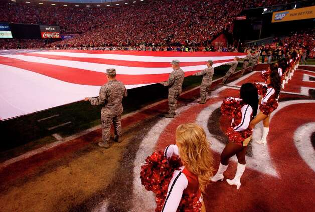 The gold rush cheerleaders and the Military before the San Francisco 49ers game against the Green Bay Packers in the NFC Divisional Playoffs at Candlestick Park in San Francisco, Calif., on Saturday January 12, 2013. Photo: Carlos Avila Gonzalez, The Chronicle / ONLINE_YES