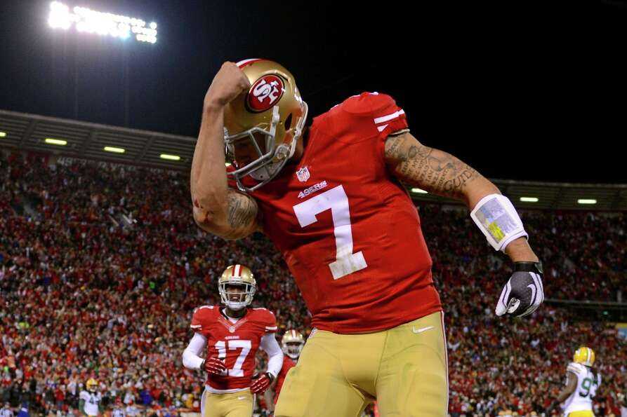 Quarterback Colin Kaepernick #7 of the San Francisco 49ers celebrates after running in a touchdown i