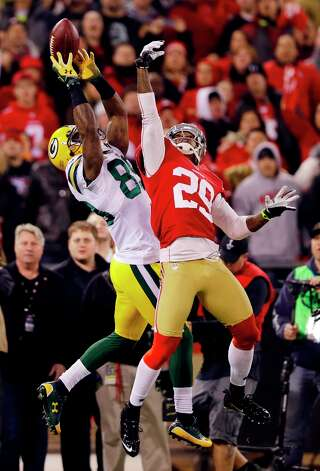 Green Bay Packers wide receiver James Jones (89) catches a pass as San Francisco 49ers cornerback Chris Culliver (29) attempts to intercept during the first quarter of an NFC divisional playoff NFL football game in San Francisco, Saturday, Jan. 12, 2013. Photo: Marcio Jose Sanchez, Associated Press / AP