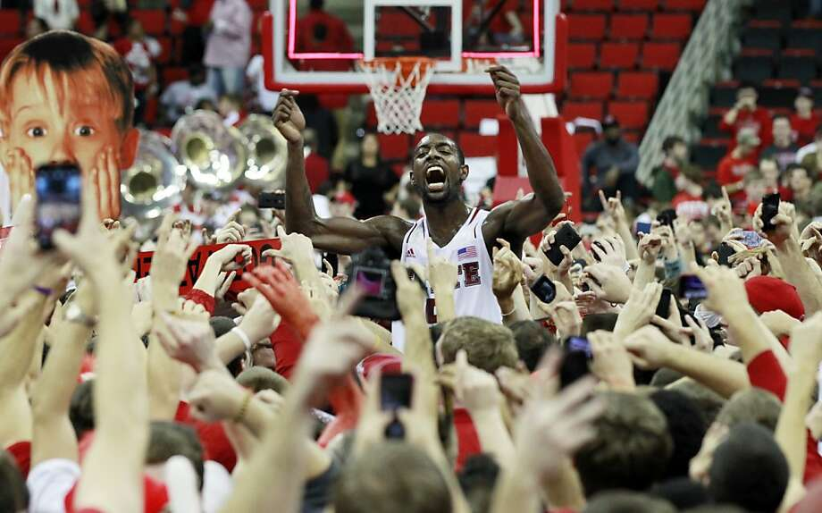 C.J. Leslie exults amid a sea of fans after North Carolina State toppled No. 1 Duke. Photo: Ethan Hyman, Associated Press