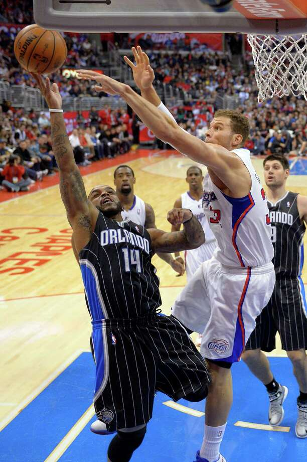 Orlando Magic guard Jameer Nelson, left, goes up for a shot as Los Angeles Clippers  forward Blake Griffin defends during the first half of their NBA basketball game, Saturday, Jan. 12, 2013, in Los Angeles. (AP Photo/Mark J. Terrill) Photo: Mark J. Terrill