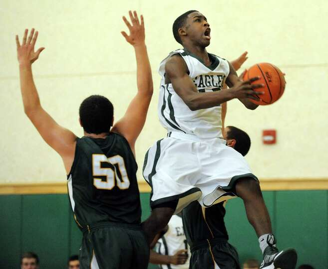Green Tech's Jamil Hood Jr. (12), right, goes to the hoop as Williamsville North's George Attea (50)