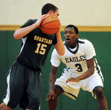 Green Tech's Jafari Coleman (3), left, defends as Williamsville North's David Birkun (15) controls the ball during their basketball game on Saturday, Jan. 12, 2013, at Green Tech High Charter School in Albany, N.Y. (Cindy Schultz / Times Union) Photo: Cindy Schultz / 00020737A