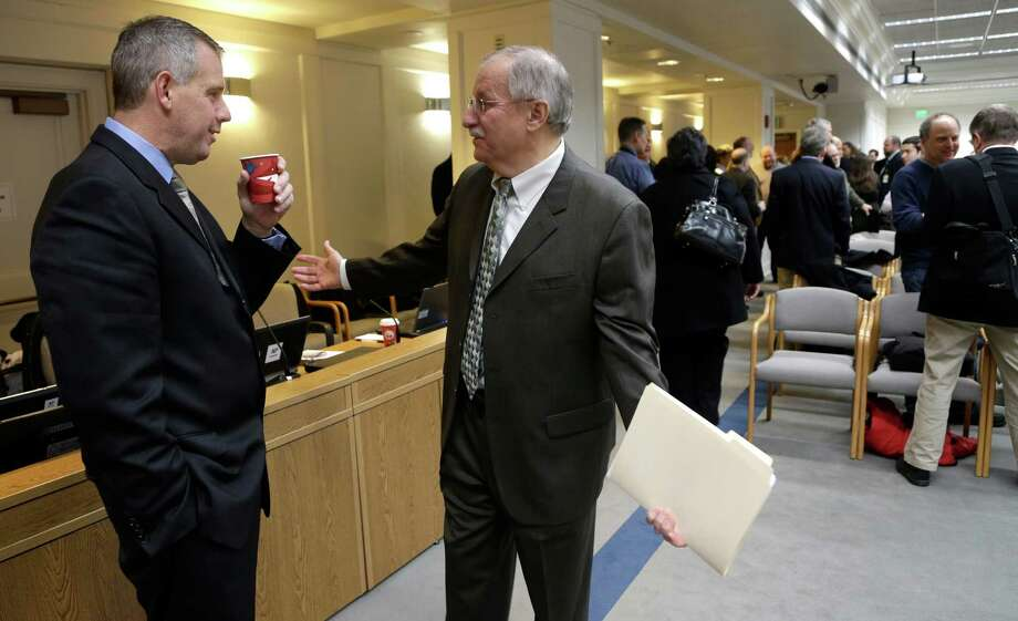 House Minority Leader Richard DeBolt, R-Chehalis, left, speaks House Speaker Frank Chopp, D-Seattle, prior to a session at the annual AP Legislative Preview, Thursday, Jan. 10, 2013, at the Capitol in Olympia, Wash. (AP Photo/Ted S. Warren) Photo: Ted S. Warren
