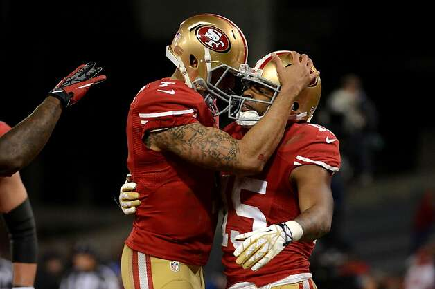 SAN FRANCISCO, CA - JANUARY 12:  Wide receiver Michael Crabtree #15 of the San Francisco 49ers hugs quarterback Colin Kaepernick #7 after a touchdown in the second quarter against the Green Bay Packers during the NFC Divisional Playoff Game at Candlestick Park on January 12, 2013 in San Francisco, California.  (Photo by Harry How/Getty Images) Photo: Harry How, Getty Images