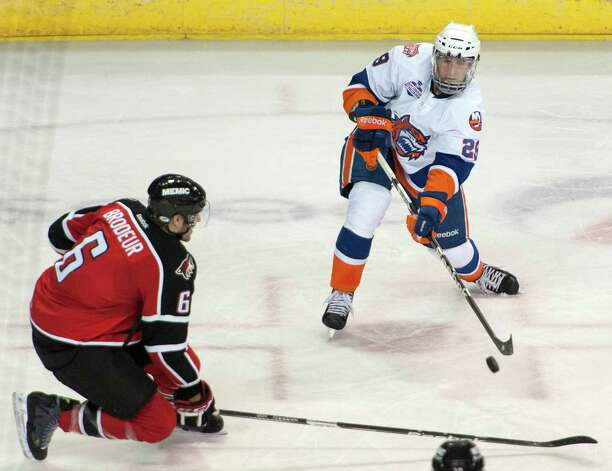 Bridgeport Sound Tigers Brock Nelson tries to control the puck in front of the Portland Pirates net in an American Hockey League game played at the Webster Bank Arena, Bridgeport, CT on Saturday January 12th, 2013. Photo: Mark Conrad / Connecticut Post Freelance