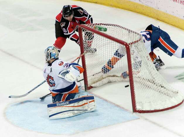 Portland Pirates Jordan Szwarz gets one by Bridgeport Sound Tigers goalie Kevin Poulin in an American Hockey League game played at the Webster Bank Arena, Bridgeport, CT on Saturday January 12th, 2013. Photo: Mark Conrad / Connecticut Post Freelance