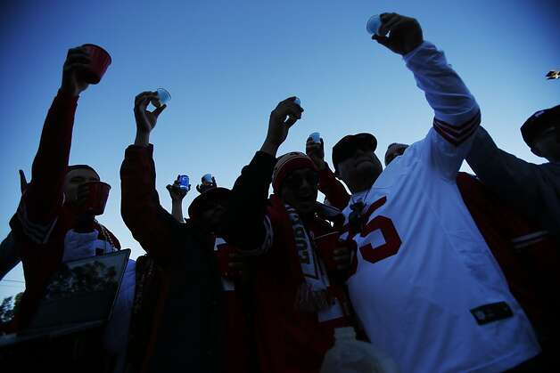 A group of football fans makes a toast prior in the parking lot outside Candlestick Park prior to a NFL football game between the San Francisco 49ers and Green Bay Packers in San Francisco, Calif. on Saturday, January 12, 2013. Photo: Stephen Lam, Special To The Chronicle