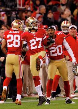 Safety C.J. Spillman (27), Cornerback Perrish Cox (20) and Running back Rock Cartwright (28) celebrator after a recovered fumble in the second quarter of the San Francisco 49ers game against the Green Bay Packers in the NFC Divisional Playoffs at Candlestick Park in San Francisco, Calif., on Saturday January 12, 2013. Photo: Carlos Avila Gonzalez, The Chronicle / ONLINE_YES