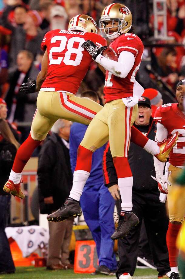 Running back Rock Cartwright (28) and Safety C.J. Spillman (27) celebrate after a recovered fumble in the second quarter of the San Francisco 49ers game against the Green Bay Packers in the NFC Divisional Playoffs at Candlestick Park in San Francisco, Calif., on Saturday January 12, 2013. Photo: Carlos Avila Gonzalez, The Chronicle / ONLINE_YES