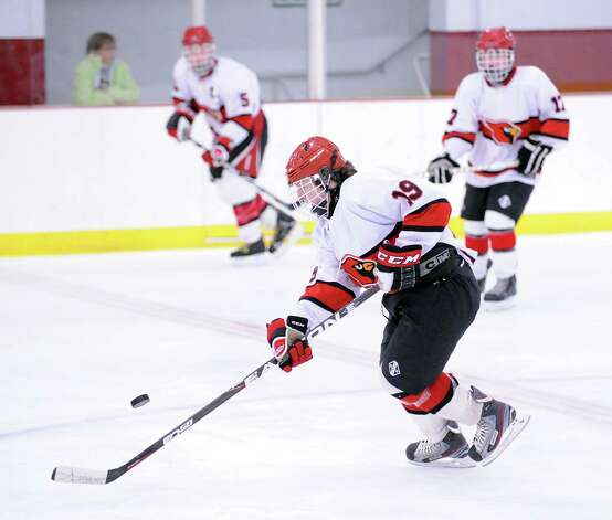 Tommy Rogan # 19 of Greenwich advances the puck during the boys high school ice hockey game between Staples-Weston-Shelton High School and Greenwich High School at Hamill Rink in Byram, Saturday night, Jan. 12, 2013. Photo: Bob Luckey / Greenwich Time