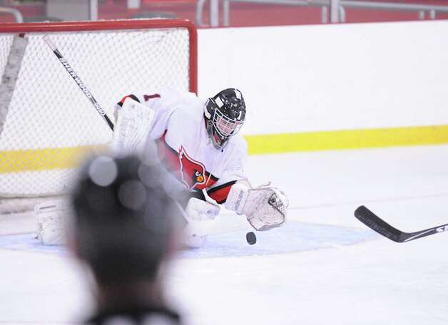 Greenwich goalie Bryan Archino makes a stop during the boys high school ice hockey game between Staples-Weston-Shelton High School and Greenwich High School at Hamill Rink in Byram, Saturday night, Jan. 12, 2013. Photo: Bob Luckey / Greenwich Time
