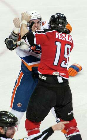 Bridgeport Sound Tigers Brett Gallant and Portland Pirates Joel Rechlicz drop the gloves in an American Hockey League game played at the Webster Bank Arena, Bridgeport, CT on Saturday January 12th, 2013. Photo: Mark Conrad / Connecticut Post Freelance